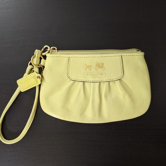 Coach Handbags - Coach Yellow Green Wristlet